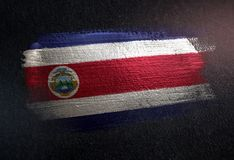 Costa Rica Flag Made of Metallic Brush Paint on Grunge Dark Wall.  royalty free stock images
