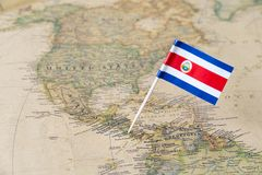 Costa Rica flag pin on world map. Paper flag pin of Costa Rica on a world map showing neighboring countries. Officially the Republic of Costa Rica, it is a royalty free stock photography