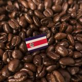 A Costa Rica flag placed over roasted coffee beans.  royalty free stock photo
