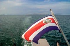 Costa Rica flaga latanie przy plecy prom Fotografia Royalty Free