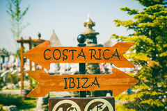 Costa Rica and Ibiza direction sign. On the beach stock photography