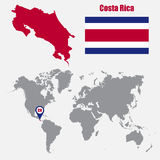 Costa Rica map on a world map with flag and map pointer. Vector illustration Royalty Free Stock Photo