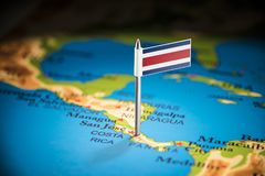 Costa Rica marked with a flag on the map. Costa Rica national marked with a flag on the map stock photography