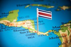 Costa Rica marked with a flag on the map. Costa Rica national marked with a flag on the map royalty free stock photo