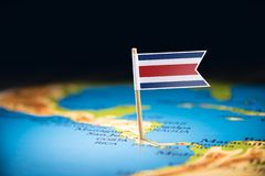 Costa Rica marked with a flag on the map. Costa Rica national marked with a flag on the map stock photos
