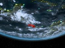 Costa Rica at night. Highlighted in red on planet Earth with clouds. 3D illustration. Elements of this image furnished by NASA Royalty Free Stock Photos