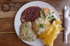 Costa rica plate, Meat With Rice and Beans. View of white plate with traditional food and meat stock photography