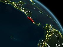 Costa Rica in red at night. Costa Rica from orbit of planet Earth at night with visible borderlines and city lights. 3D illustration. Elements of this image Royalty Free Stock Image