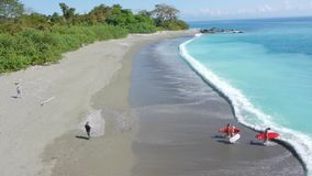 Costa Rica sandy beach surrounded with jungle stock video footage