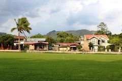 Costa Rica soccer field with houses in the back side Royalty Free Stock Photo