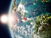 Costa Rica during sunset on Earth. Satellite view of Costa Rica highlighted in red on planet Earth with clouds and visible country borders during sunset. 3D Stock Image