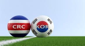Costa Rica vs Południowego Korea mecz piłkarski - piłek nożnych piłki w Costa Rica i Południowego Korea obywatelu kolory na boisk Fotografia Royalty Free