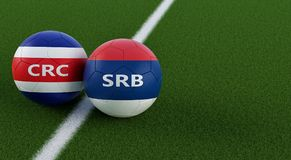 Costa Rica vs. Serbia Soccer Match - Soccer balls in Costa Ricas and Serbian national colors on a soccer field. Copy space on the right side - 3D Rendering Stock Photo