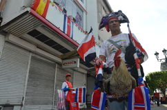 Costa Rican Cock: a fan celebrates true football passion with his rooster! Stock Image