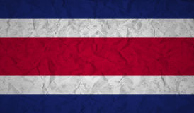 Costa Rican flag with the effect of crumpled paper and grunge Royalty Free Stock Photos