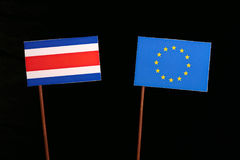 Costa Rican flag with European Union EU flag isolated on black. Background Royalty Free Stock Photo