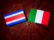 Costa Rican flag with Italian flag on a tree stump isolated stock illustration