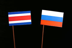 Costa Rican flag with Russian flag isolated on black Royalty Free Stock Photo