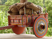 Costa Rican Ox Cart loaded with coffee bags. Colorful Costa Rican Ox Cart loaded with coffee bags Stock Photos