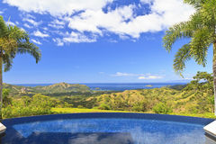 Costa Rican Paradise Pool. A swiming pool overlooking the verdant hills of Guanacaste, looking toward Play del Coco on the Pacific coast of Costa Rica Stock Photography