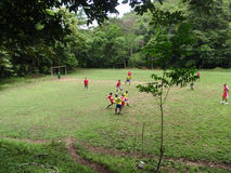 Costa Ricans Play Soccer on a field in the Woods Stock Images