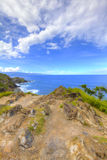 Costa tropical com opinião do oceano e da ilha Imagem de Stock