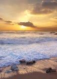Costa y sol Imágenes de archivo libres de regalías