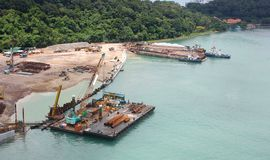 Costal construction site. Arial sea view of a coastal construction site and a floating barge royalty free stock images