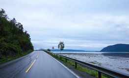 Shoreline road view in Norway during summer. Costal shoreline road view in Northern Norway during summer stock images
