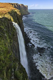 Costal waterfall with cliffs in the background Royalty Free Stock Photography