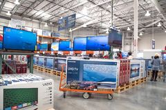 Costco Wholesale with row of big screen, smart TVs display Stock Images