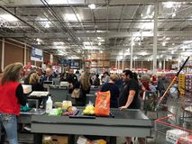 Costco Wholesale Store Cashiers Helping People Check Out The Products They Are