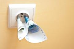 Coste de electricidad Imágenes de archivo libres de regalías