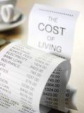 Coste de la vida en un listado Imagen de archivo libre de regalías