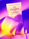 Coste de la vida en una lista de compras Imagen de archivo libre de regalías