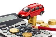 Coste del coche. con la calculadora imagen de archivo libre de regalías