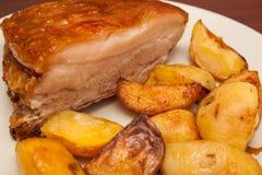 Costeleta de carne de porco com batata Fotos de Stock