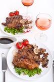 Costeleta de carne de porco com cogumelos Foto de Stock