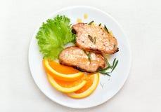 Costeleta de carne de porco com molho alaranjado Imagens de Stock