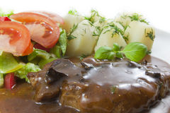 Costeleta de carne de porco com molho de cogumelo fotos de stock