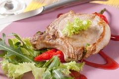 Costeleta de carne de porco do assado e acompanhamento foto de stock royalty free