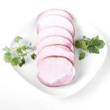 Costeleta de carne de porco fumado com fundo branco Fotos de Stock