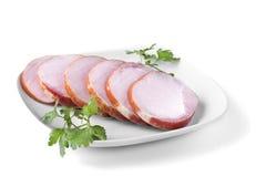Costeleta de carne de porco fumado com fundo branco Fotos de Stock Royalty Free