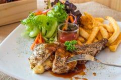 Costeleta de carne de porco grelhada com queijo Foto de Stock Royalty Free