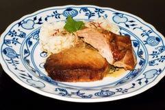 Costeleta de carne de porco Roasted com arroz do açafrão Imagens de Stock Royalty Free