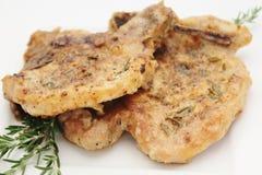 Costeletas de carne de porco com alecrins Fotografia de Stock