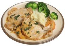 Costeletas de carne de porco com molho do sábio & de Apple Foto de Stock