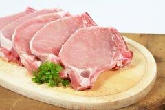 Costeletas de carne de porco com ossos Imagens de Stock