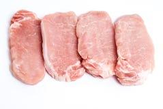 Costeletas de carne de porco em um fundo branco Foto de Stock