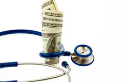 Costes de salud con las cuentas de dólar Fotografía de archivo libre de regalías
